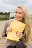 Woman holding envelopes Royalty Free Stock Photos