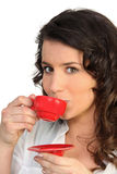 Woman holding espresso Stock Photos