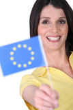 Woman holding an EU flag Royalty Free Stock Photos