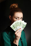 Woman holding euro bills Stock Photography