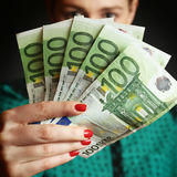 Woman holding euro bills Stock Image