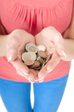 Woman holding euro coins in her hands Stock Photos