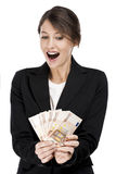 Woman holding euro currency notes Royalty Free Stock Photos