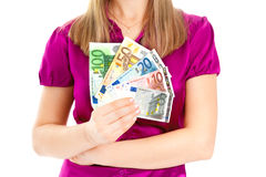 Woman holding euro in her hands Stock Images