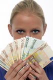 Woman holding euro money Royalty Free Stock Photos
