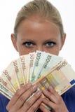 Woman holding euro money Royalty Free Stock Photos