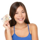 Woman holding euro money note. Pretty young model showing 50 euro bill. Closeup of gorgeous multi-ethnic Asian / Caucasian woman model isolated on white royalty free stock photography
