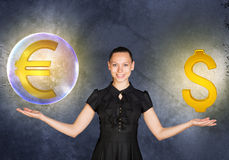 Woman holding euro sign in bubble and dollar. Busineswoman holding euro sign in big bubble and dollar sign on grey background Stock Photos