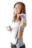 Woman holding euros bills and house model Royalty Free Stock Photo