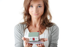 Woman holding euros bills and house model Stock Photography