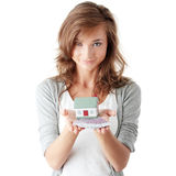 Woman holding euros bills and house model Royalty Free Stock Photos