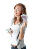 Woman holding euros bills and house model Stock Photos