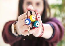 Woman holding evil eye bracelets - greek jewelry advertisement Royalty Free Stock Photos