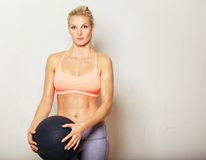 Woman Holding Exercise Ball Stock Photography
