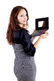 Woman holding eyeshadow set Stock Images
