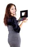 Woman holding eyeshadow set Stock Images