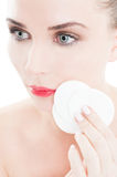 Woman holding face cleaner cotton disc. As beauty concept royalty free stock photography