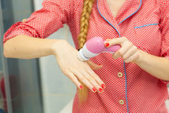 Woman holding facial cleansing brush Stock Image