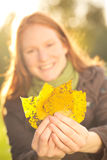 Woman Holding Fall Leaves Stock Photos