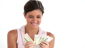 Woman holding a fan of dollars Stock Image