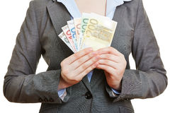 Woman holding fan of Euro money banknotes Royalty Free Stock Photo