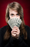 Woman holding fan of money Royalty Free Stock Photo