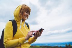 Woman holding in female hands gadget technology, tourist young girl on backgroundblu sky using mobile smartphone, smile hiker enjo. Y recreation, text message stock image