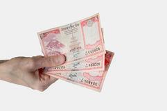Woman holding fifteen Nepal Rupees notes in her hand. Woman holding fifteen Nepal Rupees banknotes in her hand Royalty Free Stock Photo