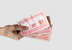 Woman holding fifteen Nepal Rupees notes in her hand Stock Images