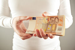 Woman holding fifty euros stack Stock Photos