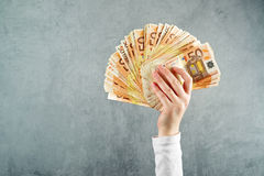 Woman holding fifty euros stack Stock Images