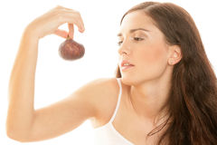Woman holding fig. Portrait of young woman holding fig isolated on white background royalty free stock photo