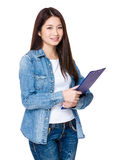 Woman holding with file board Stock Photography
