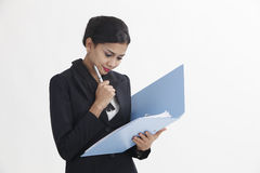 Woman holding file Stock Photo