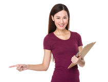 Woman holding file and finger point aside Stock Images