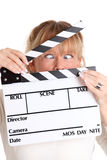 Woman holding a film slate Royalty Free Stock Images