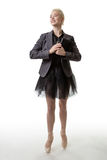 Woman holding a filofax. Wearing a tutu and a suit jacket, toes en pointe Royalty Free Stock Photo