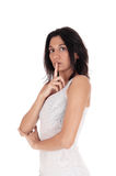 Woman holding finger over mouth. Royalty Free Stock Images