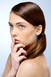 Woman holding a finger to her lips Stock Image