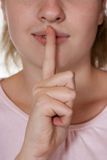 Woman holding finger to lips. Gesture for silence Stock Photos