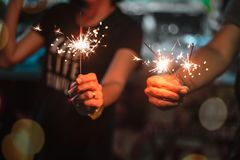 Woman holding fireworks. On New Year`s Day stock photo