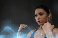 Woman holding fists and fighting in gym Stock Photo