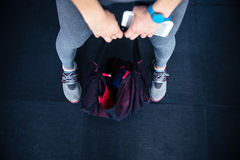 Woman holding fitness bag and smartphone Stock Images