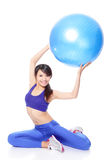 Woman holding fitness ball up Stock Photos