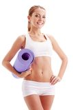 Woman holding fitness mat Royalty Free Stock Image