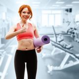 Woman holding fitness mat Stock Photo