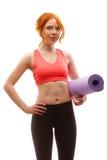Woman holding fitness mat Stock Photos