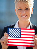Woman holding flag of the USA Royalty Free Stock Image