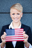 Woman holding flag of the USA Stock Images