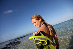 Woman holding flippers Royalty Free Stock Photos